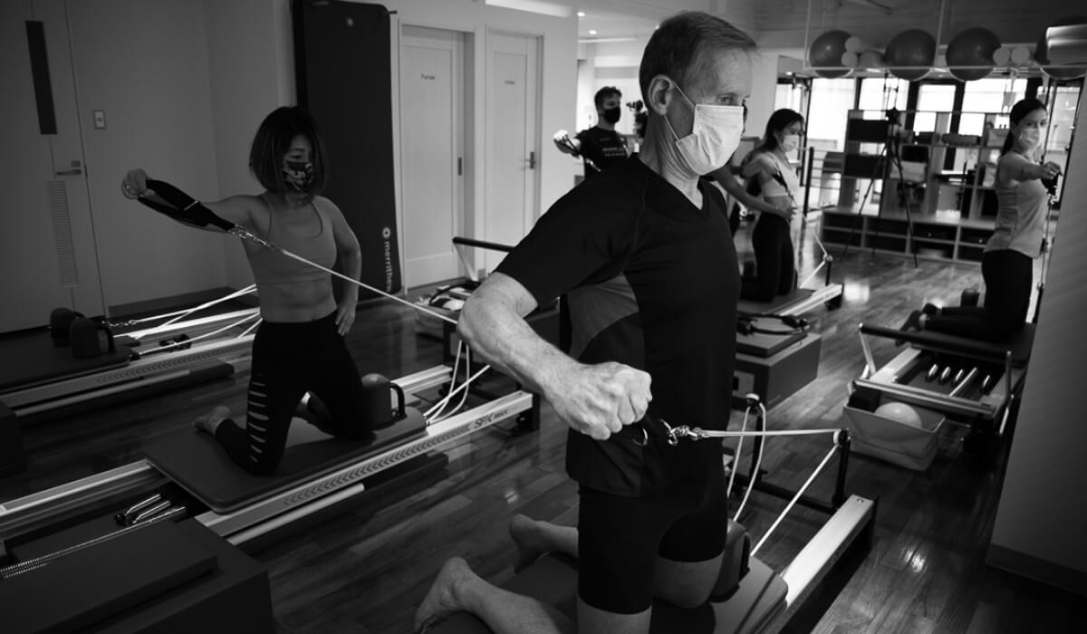 Group reformer class: shoulder exercise